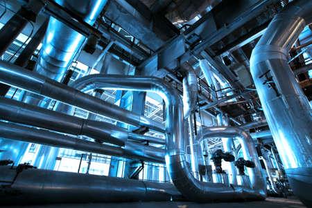 Foto de Equipment, cables and piping as found inside of  industrial power plant - Imagen libre de derechos