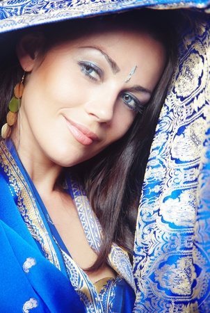 Elegant smiling lady in stylish blue wedding sari. Natural colors. Vertical photo