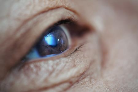 Photo pour Close-up view on the eye of senior man. Horizontal photo - image libre de droit