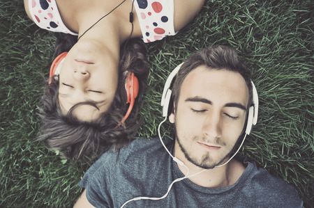 Photo for Couple listening to music on headphones - Royalty Free Image