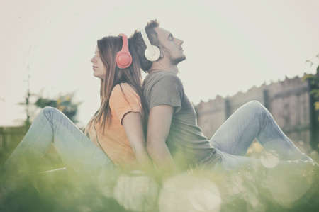 Photo for Boy and girll listening to music on headphones - Royalty Free Image