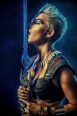 Portrait of a beautiful female warrior in battle. Ancient times. Amazon.