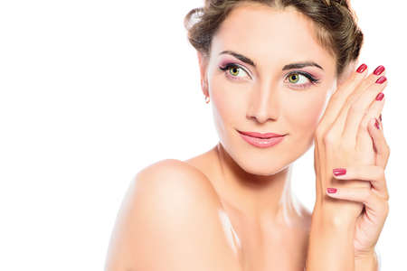 Beautiful female face with pure skin and natural make-up. Spa girl. Skincare, healthcare. Isolated over white background. Copy space.