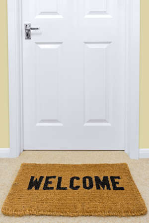Photo for A Welcome doormat in front of a door. - Royalty Free Image