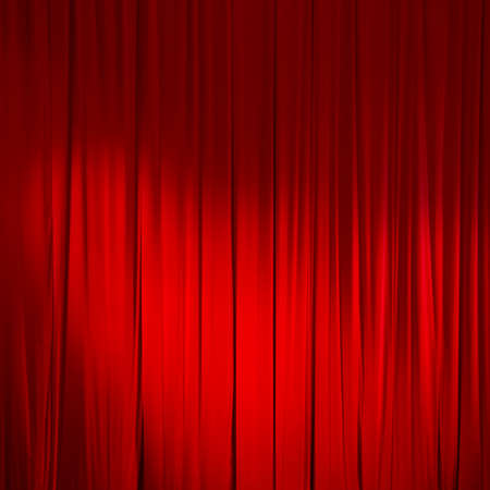 Red closed curtain with light spots in a theater.