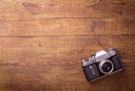 Photo for Retro camera on wood table background, vintage color tone - Royalty Free Image