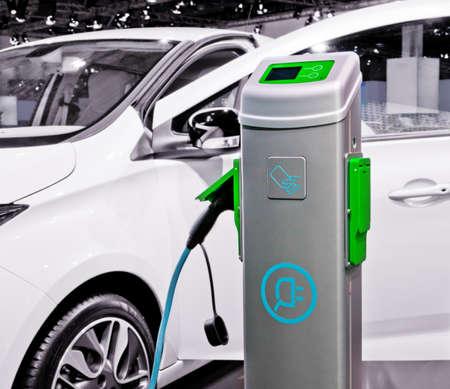 Photo pour Plug-in electric car being charged. - image libre de droit