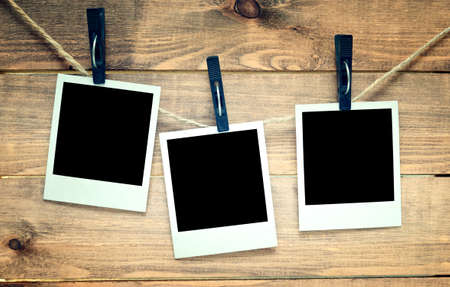Photo for empty polaroid photo frames on wooden background - Royalty Free Image