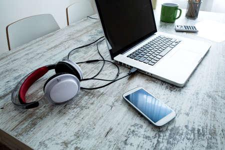 Foto de Electronics and a Laptop computer on a Desktop - Imagen libre de derechos