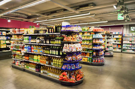 Photo pour GENEVA, SWITZERLAND - SEPTEMBER 18, 2015: interior of Migros supermarket. Migros is Switzerland's largest retail company, its largest supermarket chain and largest employer - image libre de droit