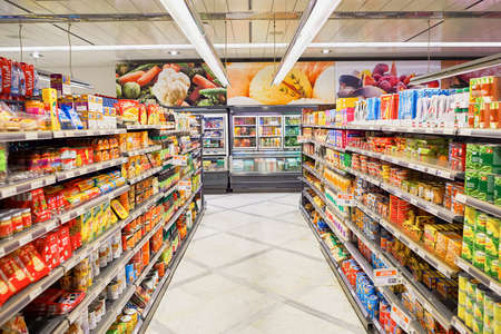 Photo pour GENEVA, SWITZERLAND - SEPTEMBER 19, 2015: interior of Migros supermarket. Migros is Switzerland's largest retail company, its largest supermarket chain and largest employer - image libre de droit