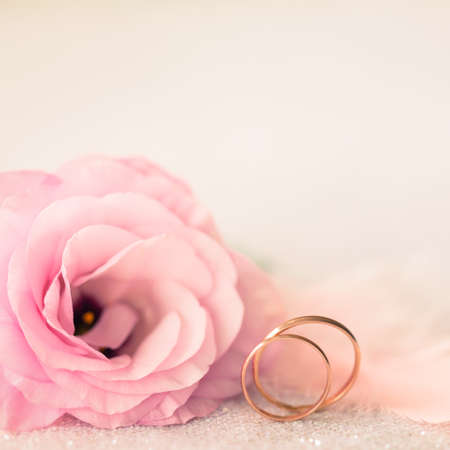 Photo for Vintage Sile Wedding Background with Gold Rings and Beautiful Flower - Royalty Free Image