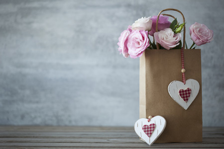 St. Valentines Day minimalistic background with pink flowers and hearts