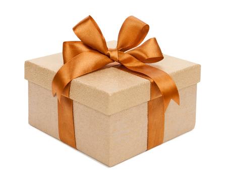 Foto de Gift box with gifts and brown bow. - Imagen libre de derechos
