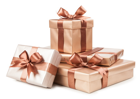 Photo for Gold boxes with gifts and brown bow isolated on white. - Royalty Free Image