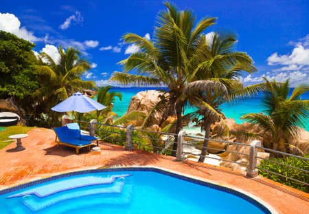 Photo for Pool in hotel at tropical beach, Seychelles - vacation background - Royalty Free Image