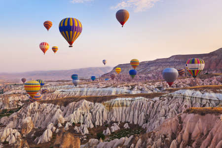 Photo for Hot air balloon flying over rock landscape at Cappadocia Turkey - Royalty Free Image
