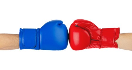 Foto de Boxing gloves isolated on white background - Imagen libre de derechos
