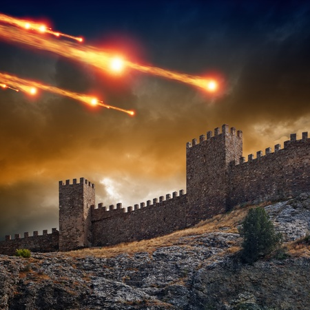 Photo pour Dramatic background - old fortress, tower under attack  Dark stormy sky, asteroid, meteorite impact - image libre de droit