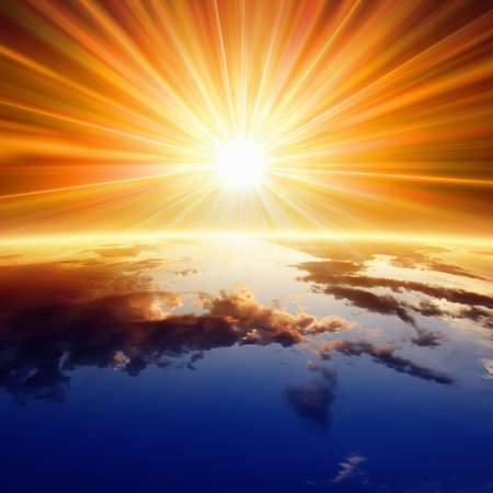 Photo for Abstract religious backgrounf - bright sun shines above planet Earth - Royalty Free Image