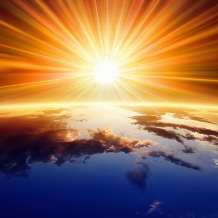 Photo pour Abstract religious backgrounf - bright sun shines above planet Earth - image libre de droit