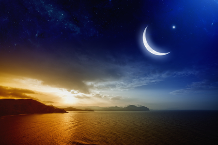 Foto de Ramadan background with moon and stars, holy month, beautiful red sunset over sea.  - Imagen libre de derechos