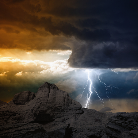 Photo pour Nature force background - bright lightning from dark clouds hits mountain  - image libre de droit