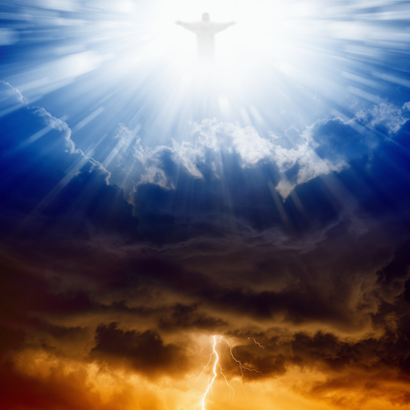Foto de Jesus Christ in blue sky with clouds, bright light from heaven, heaven and hell - Imagen libre de derechos