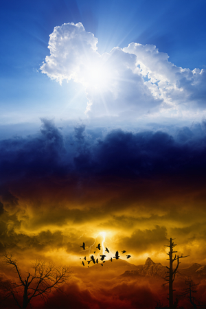 Photo pour Blue sky with sun and dark red stormy sky with lightning, heaven and hell, good and evil - image libre de droit