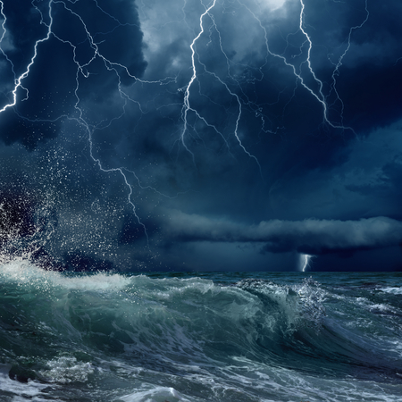 Foto de stormy sea, dark clouds with bright lightnings - Imagen libre de derechos