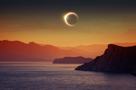Foto de Scientific background, astronomical phenomenon - full sun eclipse, total solar eclipse, mountains and sea - Imagen libre de derechos