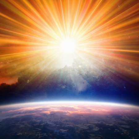 Photo pour Bright light from above shines on planet Earth. Elements of this image furnished by NASA nasa.gov - image libre de droit