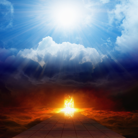 Foto de Dramatic religious background - bright light from heaven, burning doorway in dark red sky, road to hell, way to hell, heaven and hell - Imagen libre de derechos
