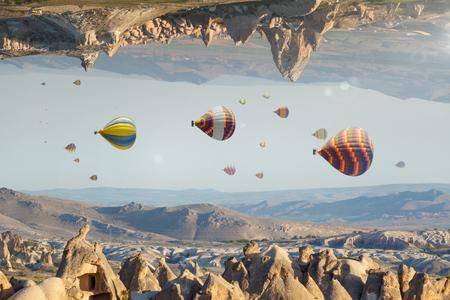 Foto de Unreal fantastic world, impossible surreal terrain, hot air balloons fly like fish in sky - Imagen libre de derechos
