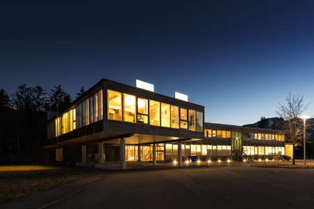 Foto de ecological energy saving wooden office building at night - Imagen libre de derechos