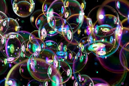 Foto de colorful soap bubbles flying around on black background - Imagen libre de derechos