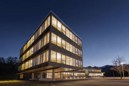 Foto de huge wooden timber sustainable office building at dawn - Imagen libre de derechos