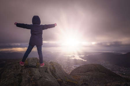 Photo for Victorious girl on top of the Mount Ulriken, Bergen, Norway - Royalty Free Image
