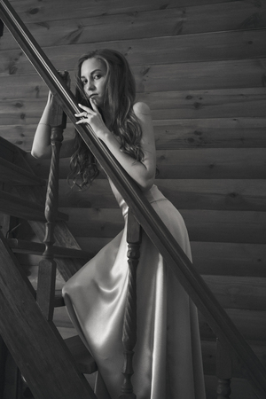 Photo for beautiful girl posing on the stairs in a pink long dress. Model in evening dress for prom - Royalty Free Image