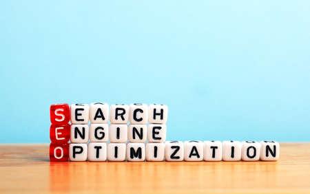 Foto de SEO Search Engine Optimization written on dices  on blue background - Imagen libre de derechos