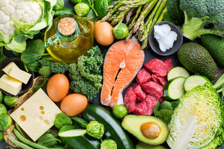 Photo pour Balanced diet nutrition keto concept. Assortment of healthy ketogenic low carb food ingredients for cooking on a kitchen table. Green vegetables, meat, salmon, cheese, eggs. Top view background - image libre de droit