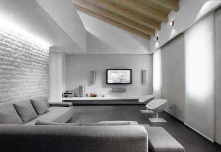 modern gray sofa in the living in a modern attic room
