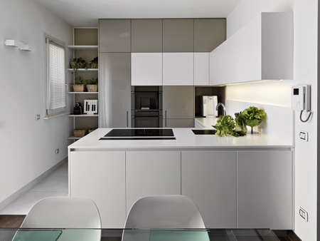 modern kitchen with vegetables on the white worktop