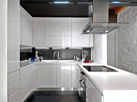 foreground of a white modern kitchen