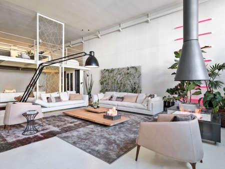 Foto de interior view of a modern living room with iron fireplace Bioethanol and loft - Imagen libre de derechos