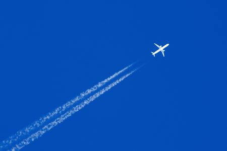 Foto de White aircraft big two engines aviation airport contrail clouds - Imagen libre de derechos