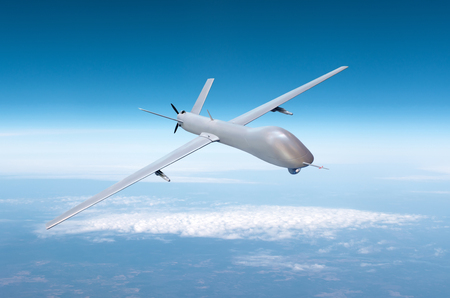 Foto de Unmanned military drone on patrol air territory at high altitude - Imagen libre de derechos