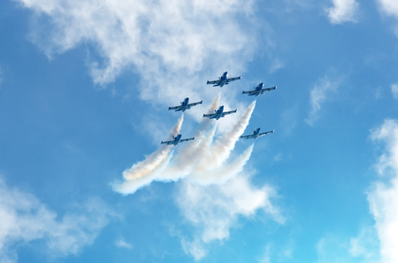 Photo for Aircraft fighter jets smoke the background of sky and sun - Royalty Free Image