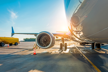 Photo for Sunset at the airport. Refueling of the airplane before flight, aircraft maintenance fuel at the airport - Royalty Free Image