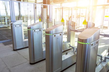 Photo pour Turnstiles for the passage of subway trains transport - image libre de droit